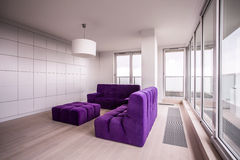 Purple and cozy furnitures Royalty Free Stock Photo