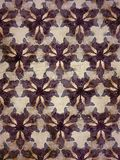 Purple, cream and brown graphical tribal design background Royalty Free Stock Images