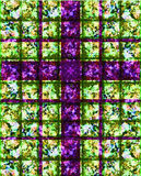 Purple Cross Stained Glass. Religious spiritual theme of a purple cross on a stained glass mosaic of colors, especially good for Easter and Christmas designs and Royalty Free Stock Image