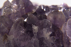 Violet crystal. Violet amethyst gemstone crystals purple and white Stock Photography