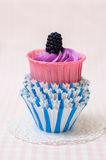 Purple cupcake in paper molds Stock Image