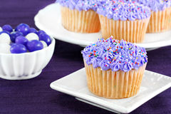 Purple cupcakes and jelly beans for Easter. Stock Photo