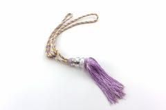 Purple curtain tassel interior decoration . Stock Photos