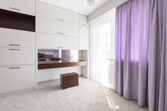 Purple curtains in the bedroom Stock Photography