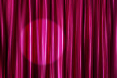 Purple curtains with light spot Stock Images