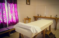 Massage table in the massage room stock photography