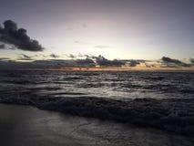 Purple Dawn above Pacific Ocean Seen from Kapaa on Kauai Island in Hawaii. Stock Photo
