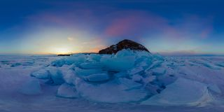 Purple dawn of ice hummocks on Lake Baikal on the island of Olkhon. Spherical 360 vr degree panoramic view