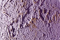 Purple decorative plaster as a background Royalty Free Stock Image