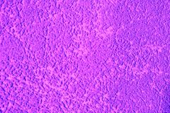 Purple decorative plaster. The texture of the plaster woodworm. Abstract rough background royalty free stock photos