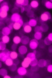 Purple defocused lights useful as a background Stock Images