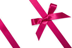 Purple diagonal ribbon with bow Stock Images
