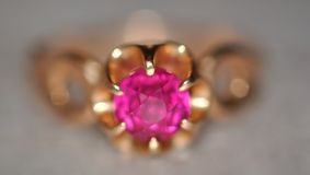 Purple diamond in gold ring Royalty Free Stock Photo