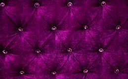 Purple diamond pattern velvet upholstery background. Dark Purple diamond pattern velvet upholstery background. Beautiful Luxury Fabric texture with buttons Royalty Free Stock Image