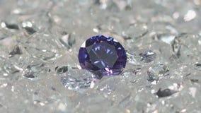 Purple diamonds are placed on a pile of white diamonds