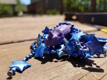 Purple dinosaur with party beads royalty free stock images