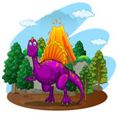 Purple dinosaur with volcano behind Stock Images