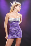 Purple diva. Cute blond in purple cocktail dress Stock Images
