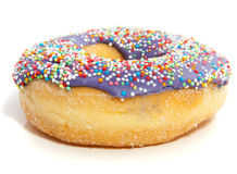 A purple donut with colorful speckles Royalty Free Stock Photography