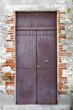 Purple Door on a Street in Italy royalty free stock photography