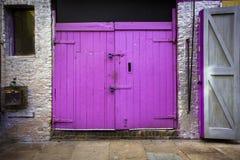 Purple doors. Purple barn type doors on building exterior Stock Photos