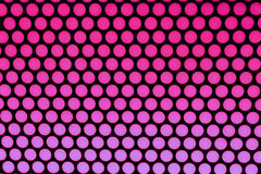 Purple dots on black. Shades of purple dots on black background Stock Images