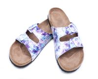 Purple Double Strap Sandals with a colorful print on the faux leather straps, with a soft micro suede foot bed and cork. Out-sole. Isolated on white background stock image