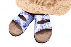 Purple Double Strap Sandals with a colorful print on the faux leather straps, with a soft micro suede foot bed and cork. Out-sole put on top of a stylish straw royalty free stock photography