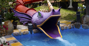 Purple dragon head water slide Stock Image
