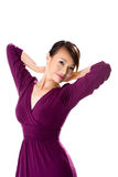 Purple Dress Asian Girl. Beautiful asian woman in purple dress with hand up holding neck Stock Photos