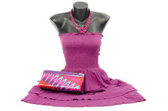 Purple dress on mannequin with matching accessories. Stock Images