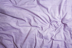 Purple duvet background Royalty Free Stock Image