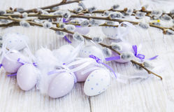 Purple Easter eggs decoration with spring buds branches Stock Images