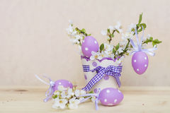 Purple easter eggs hanging on a  cherry flowers Royalty Free Stock Images
