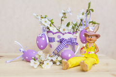 Purple easter eggs hanging on a  cherry flowers Royalty Free Stock Photography