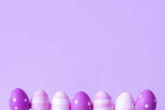 Purple easter eggs over purple background. Selective focus, copy space Royalty Free Stock Image