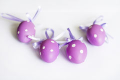 Purple easter  eggs with ribbons Royalty Free Stock Photography