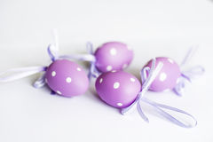 Purple easter  eggs with ribbons Royalty Free Stock Photo