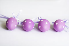 Purple easter  eggs with ribbons Royalty Free Stock Image