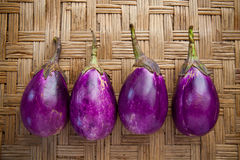 Purple eggplant on bamboo craft Royalty Free Stock Photo