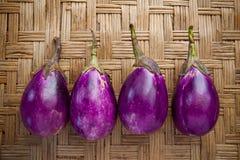 Purple eggplant on bamboo craft Royalty Free Stock Photo