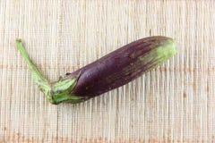 Purple eggplant on bamboo pattern background. Stock Photo