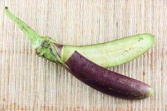Purple eggplant on bamboo pattern background. Stock Image
