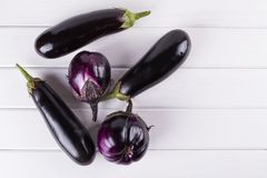 Purple eggplants of different color and variety. On the white background.. Top view Stock Images