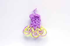 Purple elastic rainbow loom bands dress shaped . Royalty Free Stock Photos