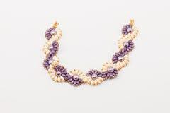 Purple en ivoorarmband Stock Foto
