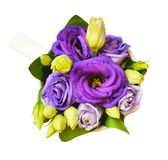 Purple eustoma flowers in a cup Royalty Free Stock Photo