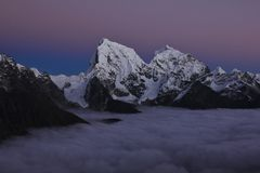 Purple evening sky over mount Cholatse and Taboche Stock Image