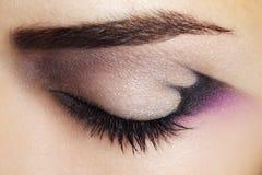 Purple Eye Makeup. Beautiful eye makeup close up royalty free stock image