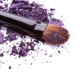 Purple eye shadow with brush Stock Photography